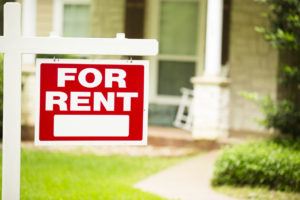 "Wellsville Rental Property with a ""For Rent"" Sign in the Front Yard"