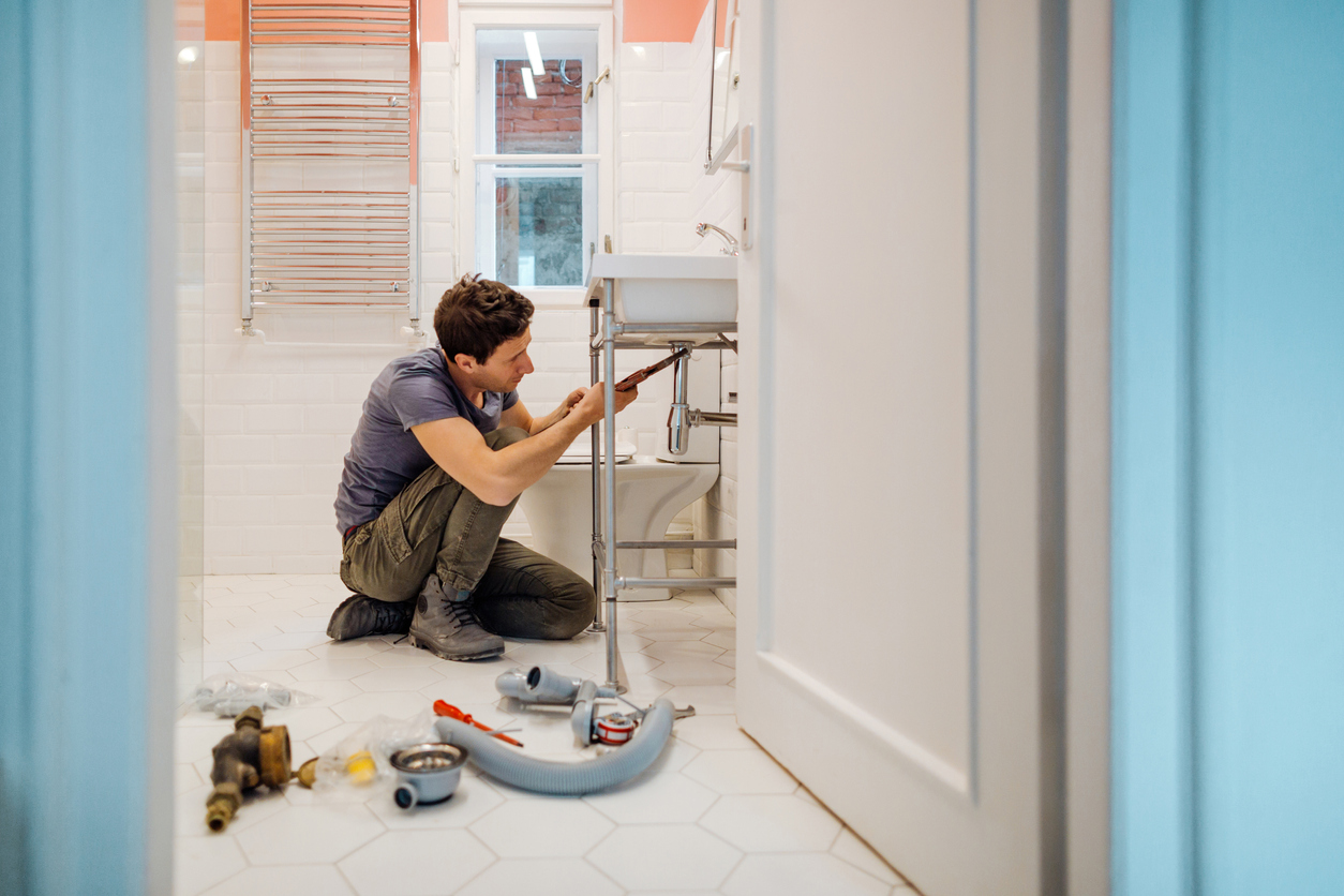 Portsmouth Landlord Fixing a Sink in the Bathroom