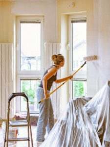 Young Woman Painting the Walls of Her Rental Home