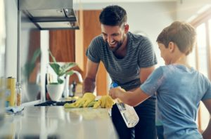 Albuquerque Family Cleaning the Stove with Organic Products