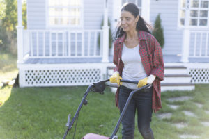 Gonzales Woman Mowing the Lawn