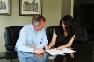 Tenant Signing a Lease for a Tillmans Corner Rental Home