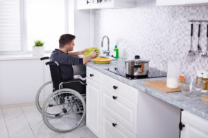 Mystic Tenant Cleaning Dishes in the Kitchen from His Wheelchair
