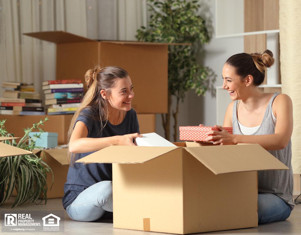 Roommates Unboxing Belongings in Randolph Rental Home