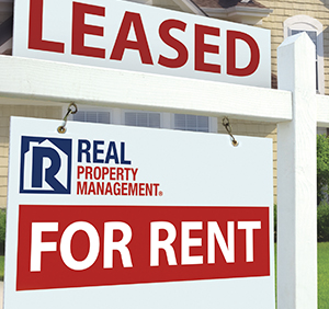 "A Real Property Management ""For Rent"" Sign"