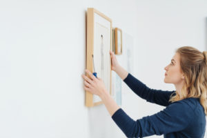 Norwalk Tenant Hanging Artwork in Their New Home