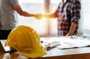 construction worker team hands shaking
