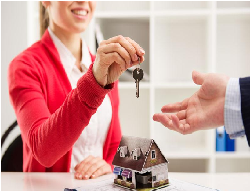 Property Manager Handing Keys to a New Resident