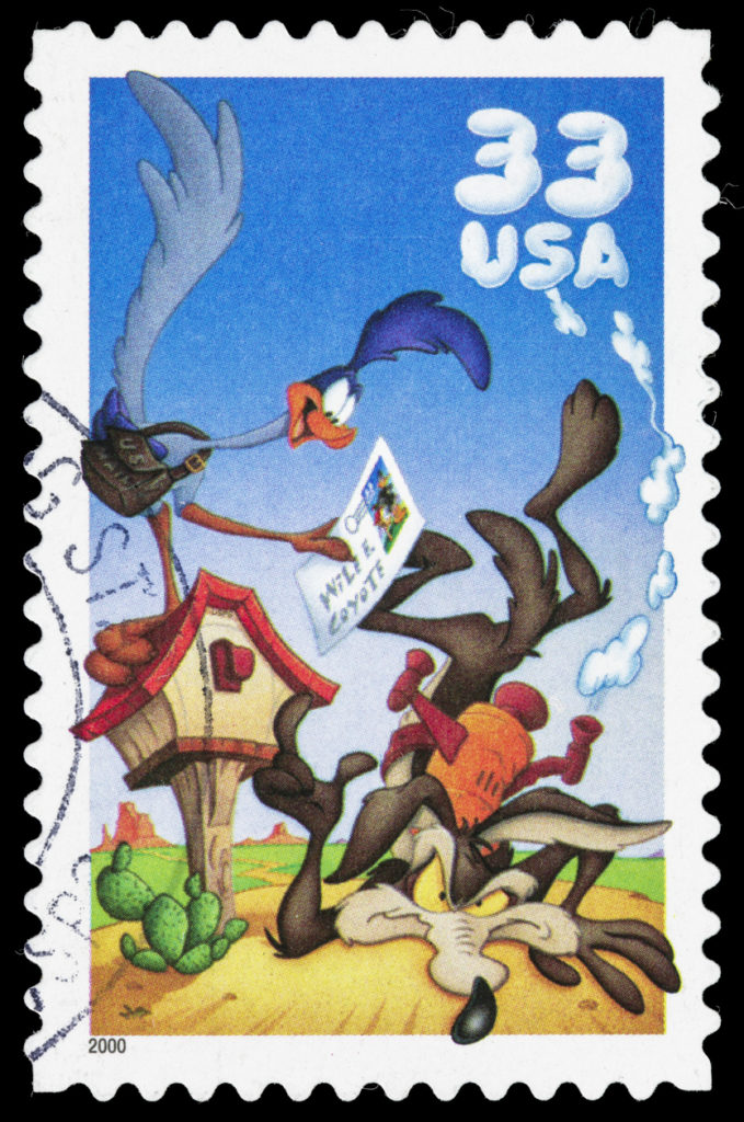 USA postage stamp with an illustration of the Looney Tunes cartoon character The Road Runner and Wile E. Coyote.