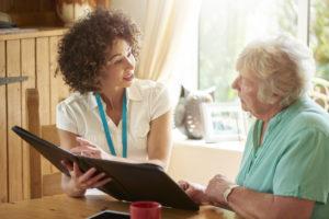 Kalamazoo Landlord Explaining the Lease to an Elderly Tenant