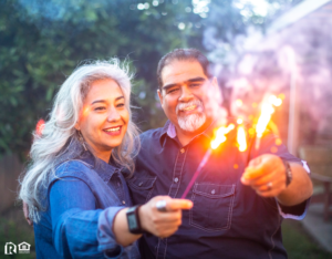 Cary Couple Holding Sparklers Together