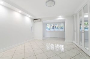Empty apartment with white tile and white walls