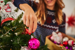 Upper Marlboro Resident Hanging an Ornament on the Christmas Tree