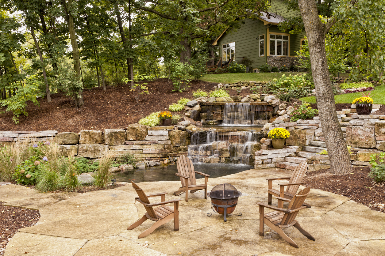 Queens Rental Property with Elaborate Landscaping, Concrete Patio, and Custom Waterfall