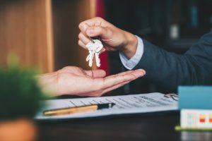 Flushing Investor Being Handed a Set of Keys