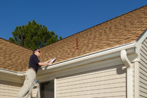 Home inspector examines a residential roof vent pipe