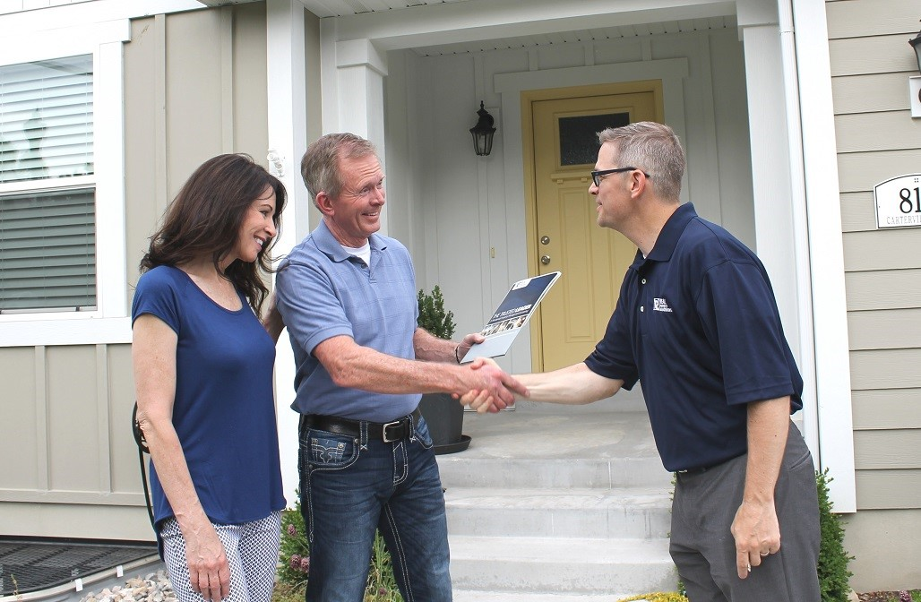 Property owner shaking hands with RPM Utah County property manager