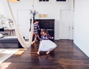 A Mother Playing the Piano While Her Daughter Dances on Hardwood Floors
