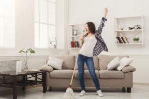Hazleton Woman Tidying the Living Room