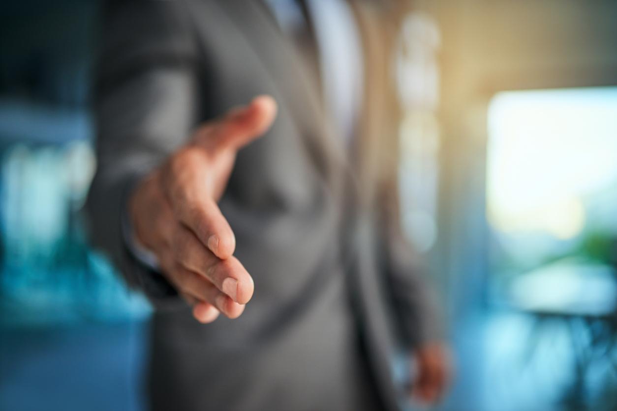 Business Man Extending a Hand Forward in Trust