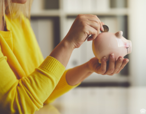 Clovis Woman Saving Change in a Piggy Bank