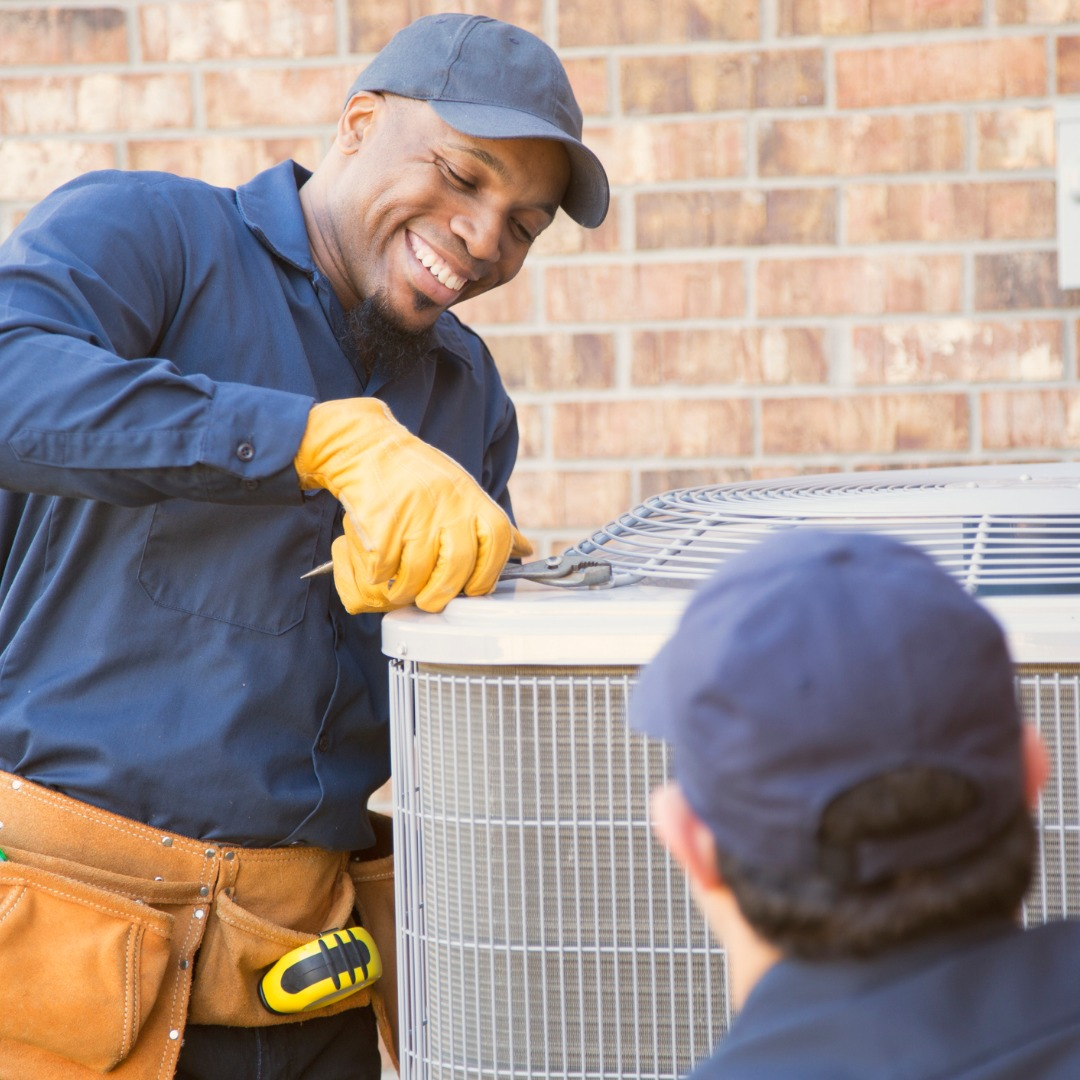 multiethnic-team-of-blue-collar-air-conditioner-repairmen-at-work-picture-id944678614