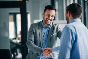 Man Shaking Hand with his Real Estate Partner