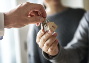 A Temecula property manager hands over keys to new tenants