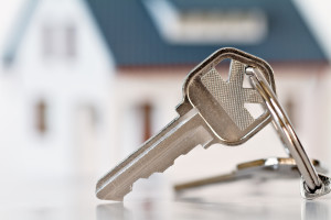 House Keys With Home In Background