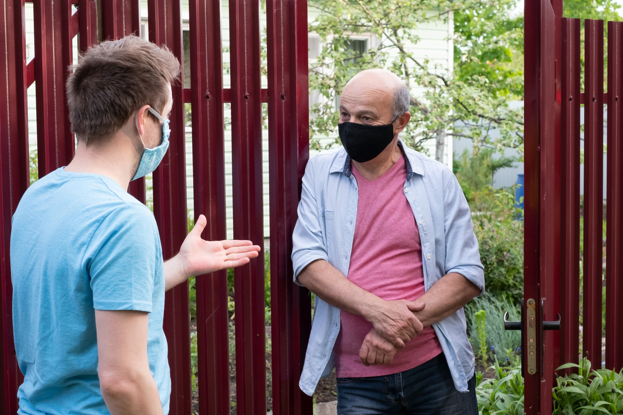 Two neighbors getting to know each other with face masks