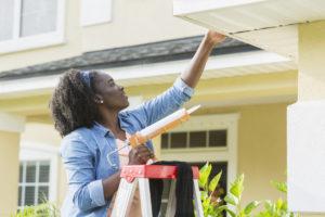 Woman Making Repairs to Her Rental Property in Slaton