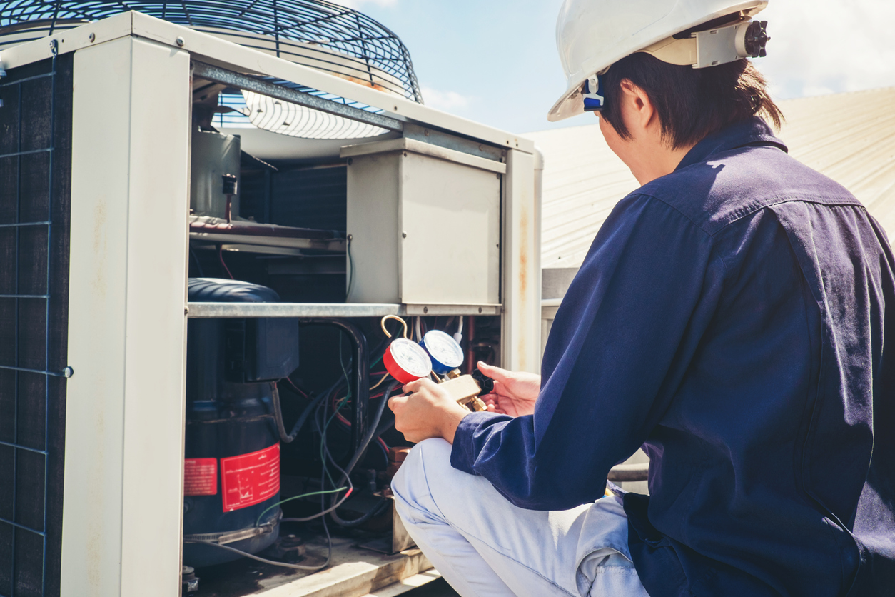 Technician Checking Air Conditioner at a Rental Home in Ransom Canyon