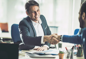 Davenport Investor Shaking Hands with a Business Partner