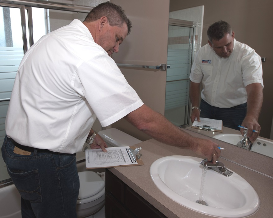 Checking the Bathroom Faucets During a Kingman Rental Property Assessment