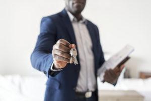 Goldman Valley Real Estate Investor Holding Out a Set of Keys