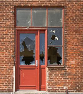 Raleigh Court Rental Property with a Broken-In Door and Windows