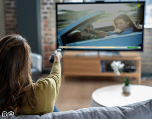 Royal Oak Tenant Relaxing at Home Watching Cable TV