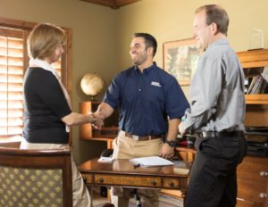 Pflugerville Property Manager Shaking the Hands of Happy Tenants