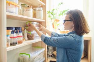 Austin Tenant Organizing the Pantry in Their Kitchen