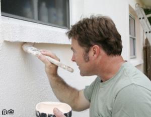 Man Painting the Exterior of a Ballard Rental Property