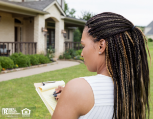 Woman writing her evaluation after doing a home inspection