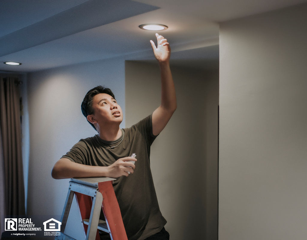 Mountain House Tenant Changing a Lightbulb