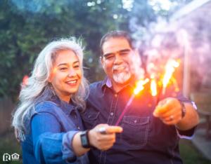 Safety Harbor Couple Holding Sparklers Together