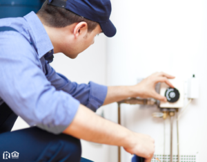 Man Fixing a Water Heater in Sugarland Rental Property