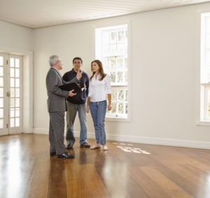 Realtor Showing a Vacant Property to a Couple in Evansville