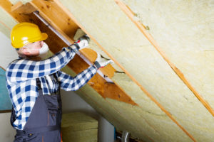 Maintenance Man Working on Insulation in the Attic of a Mt Vernon Rental Home