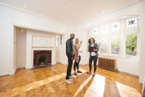 Kendall Real Estate Agent Showing Property Investors a Refurbished Home
