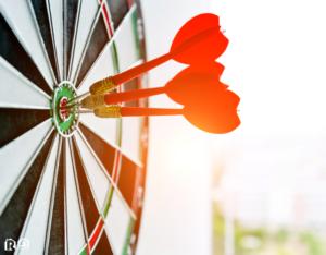 Trio of Darts Hitting the Target's Bullseye