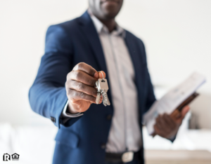 Dallas Real Estate Investor Holding Out a Set of Keys