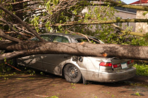 A Resident's Car Has Been Damaged by a Natural Disaster in Bryan-College Station